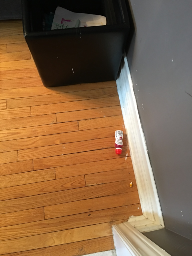photo of yogurt drink on the floor
